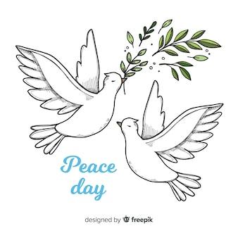 Światowy dnia pokoju tło z gołąbkami w ręka rysującym stylu