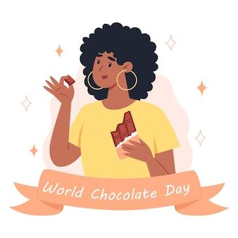 Światowy dzień czekolady młoda kobieta je tabliczkę czekolady