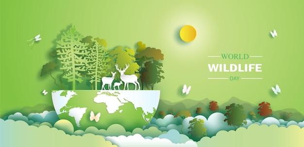 Światowy dzień dzikiej przyrody z rodziną jeleni i motylem w lesie styl wycinania papieru z papieru