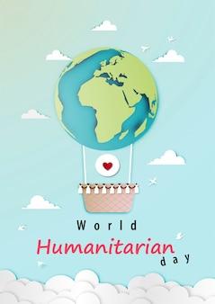 Światowy dzień humanitarny z balonem jako planeta w stylu sztuki papierowej