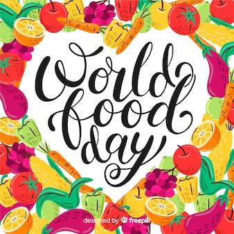 Światowy dzień jedzenia napis z dużą ilością warzyw