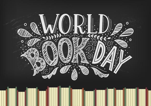 Światowy dzień książki. książki z ręcznie rysowane napis na tle czarnej tablicy.