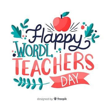 Światowy dzień nauczycieli napis z czerwonym jabłkiem