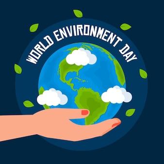 Światowy dzień ochrony środowiska z planetą i ręką