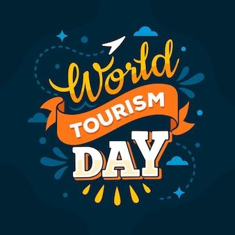 Światowy dzień turystyki - koncepcja napisu