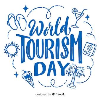 Światowy dzień turystyki napis z elementami podróży