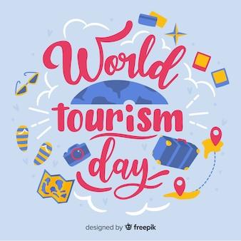 Światowy dzień turystyki napis z obiektami podróży
