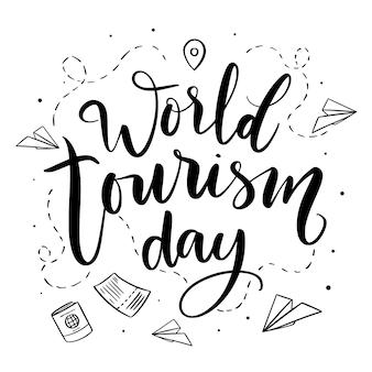 Światowy dzień turystyki napis z papierowymi samolotami