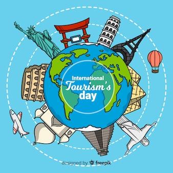 Światowy dzień turystyki tło w ręka rysującym stylu