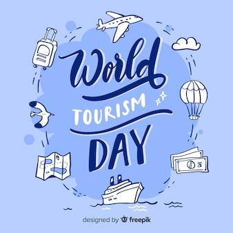 Światowy dzień turystyki z napisem przedmiotów podróży