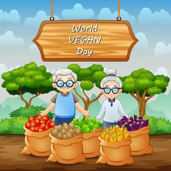 Światowy dzień wegan na znaku z parą warzyw i dziadków