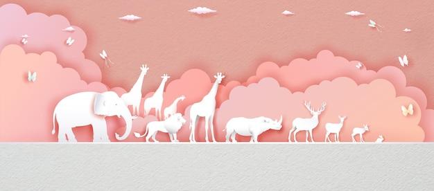 Światowy dzień zwierząt na różowym tle z jeleniem, słoniem, lwem, żyrafą, królikiem, nosorożcem w stylu papierowym, wycinanym z papieru i origami. ilustracja światowy dzień dzikiej przyrody zwierząt w tekstury papieru.
