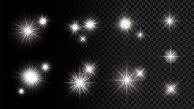 Świecą srebrne gwiazdki. na białym tle światła, festiwal party rocznica wektor kolekcja elementów dekoracyjnych. ilustracyjna błyszcząca impreza, migoczący blask gwiazdy, świecące jasno