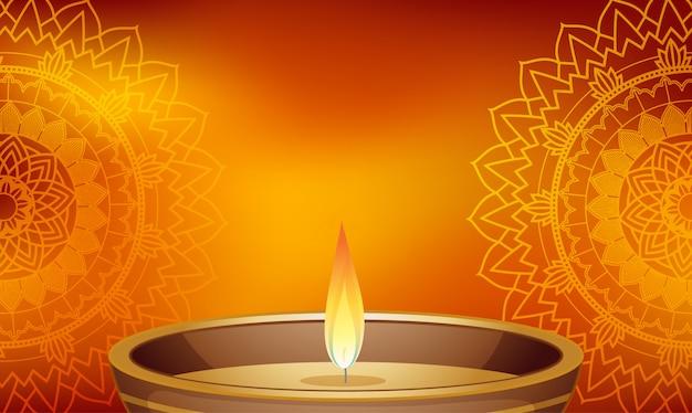 Świeca światło na tle mandali