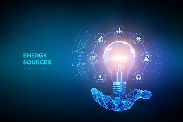 Świecące żarówki z ikonami zasobów energii w ręku. koncepcja oszczędzania energii elektrycznej i energii. źródła energii.
