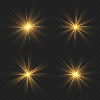 Świecące złote gwiazdy na białym na czarnym tle