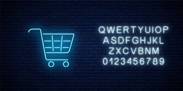 Świecący neonowy znak koszyka w supermarkecie na ciemnym murem