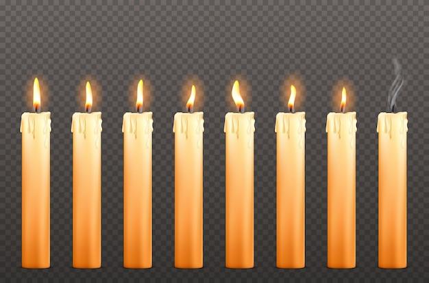 Świece o różnych płomieniach ognia i woskowych kroplach