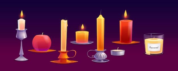 Świece woskowe o różnych kształtach z ogniem i aromatyczną parafiną.
