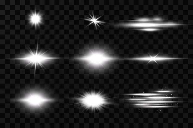 Świecić na białym tle światło gwiazd. efekt świecącego światła. zestaw błysków, świateł i błysków. jasne złote błyski i odblaski.