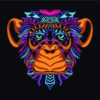 Świecić na ciemnej, dekoracyjnej twarzy małpy