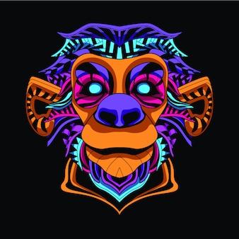 Świecić na ciemnej twarzy małpy