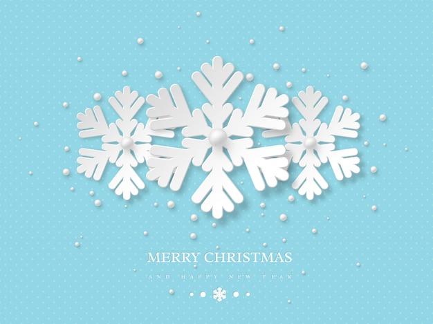 Święta bożego narodzenia. trzy płatki śniegu w stylu cięcia papieru z cieniem i perłami. niebieskie tło kropkowane z tekstem powitania, ilustracji wektorowych.