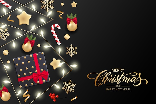 Święta z życzeniami wesołych świąt i szczęśliwego nowego roku z lampkami choinkowymi, złotymi gwiazdkami, płatkami śniegu, pudełkiem prezentowym