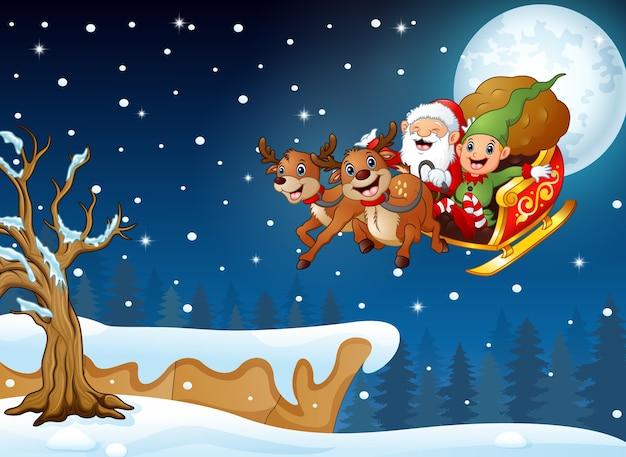 Święty mikołaj i elf przesuwne w snowing hill