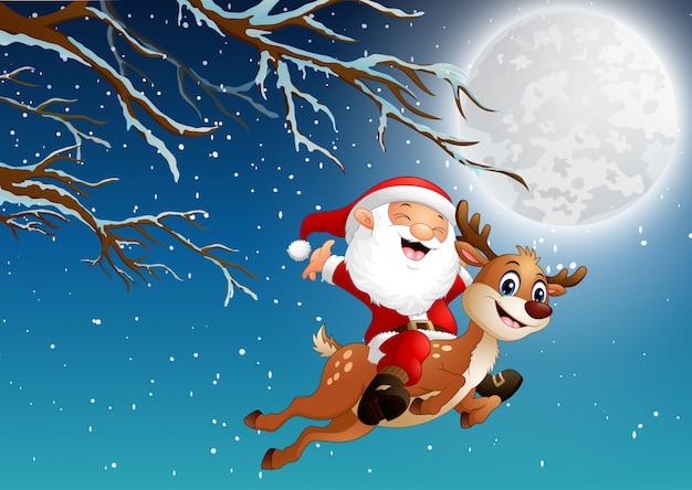 Święty mikołaj jedzie renifera nad noc bożonarodzeniową
