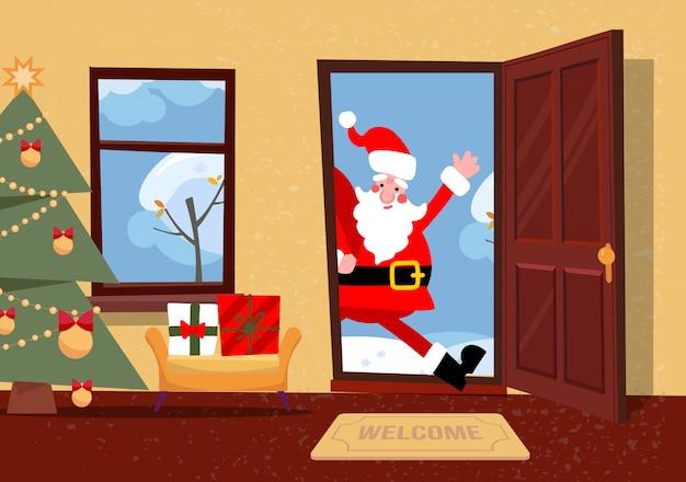 Święty mikołaj patrzy w drzwi.