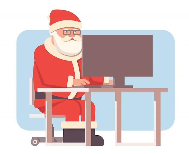 Święty mikołaj siedzieć przy komputerze.