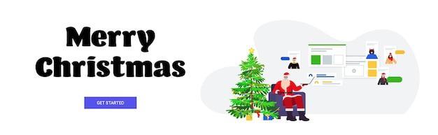Święty mikołaj w masce omawiający z ludźmi rasy mieszanej podczas rozmowy wideo szczęśliwego nowego roku wesołych świąt bożego narodzenia uroczystość koncepcja komunikacji online poziomy baner
