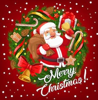 Święty mikołaj z torbą na prezent świąteczny i dzwonkiem bożonarodzeniowym w ramce z życzeniami świątecznego wieniec zimowy.
