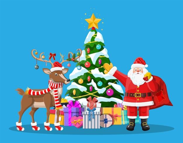 Święty mikołaj z torbą pełną prezentów i jego reniferem