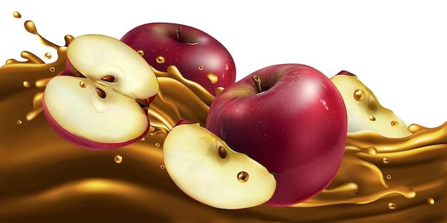 Świeże czerwone jabłka na fali soku owocowego.