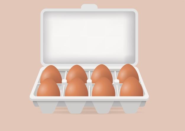 Świeże jajka w pudełku kartonowym