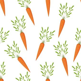 Świeże marchewki z zielonymi liśćmi bez szwu na białym tle