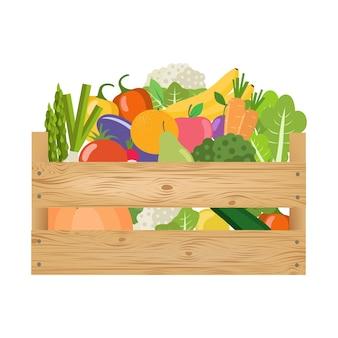 Świeże, zdrowe warzywa i owoce w drewnianym pudełku.