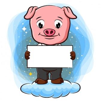 Świnia stoi na chmurze i trzyma czysty papier