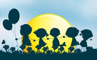 Sylwetek dzieci trzyma ręki w parku