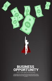 Sylwetka biznesmen pływające z kropli pieniędzy z góry. koncepcja sukcesu inwestycji i wzrostu w biznesie