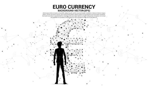 Sylwetka biznesmen stojący z ikoną waluty euro pieniędzy