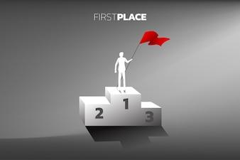 Sylwetka biznesmen z czerwoną flagą na podium mistrz.