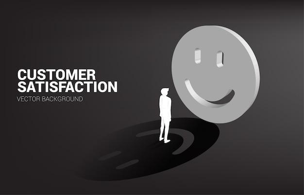 Sylwetka biznesmena pozycja z 3d uśmiechu ikony oceną