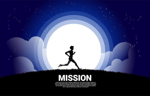 Sylwetka biznesmena uruchomić na księżycu i gwiazdach. koncepcja wizji i celu misji biznesowej.