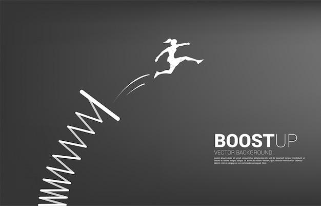 Sylwetka bizneswoman skacze wyżej z trampoliny. koncepcja ożywienia i wzrostu w biznesie.