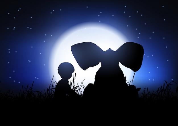 Sylwetka chłopca i słonia sylwetki na tle nocnego nieba