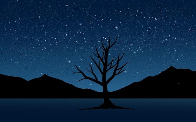 Sylwetka drzewa i góry w nocy z gwiazdami