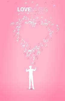 Sylwetka dyrygenta stojącego z sercem